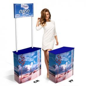 Tavolino promozionale in cartone   Cartone microonda rivestito  ;  Con Crowner (CR) o senza (PP) ;  Vano posteriore con sportello ;  Facilissimo montaggio e trasporto ;  Completo di scatola in cartone